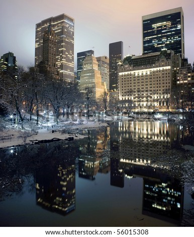 Photo of New York City buildings as viewed from Central Park at night.  Taken December 19, 2008. - stock photo