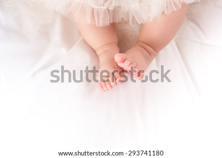 Photo of newborn baby feet - stock photo