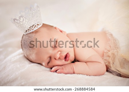 Photo of newborn baby sleeping on a white background