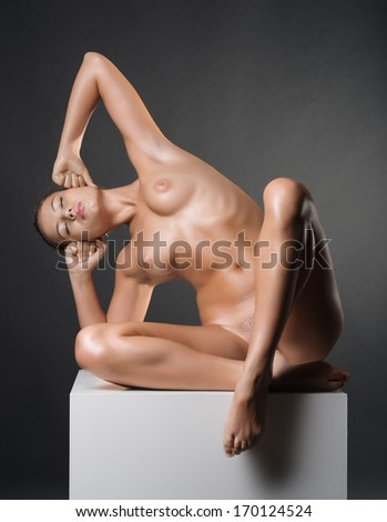 Photo of nude beautiful woman in studio - stock photo