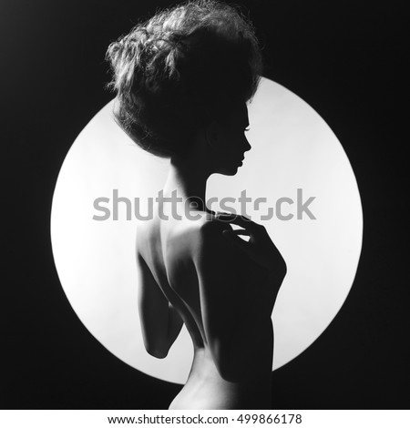 Photo of nude elegant woman on geometric background. Beautiful nude lady with big hairs. Art portrait of nude woman. Erotic photo of elegant nude lady. Naked body of elegant woman. perfect female body