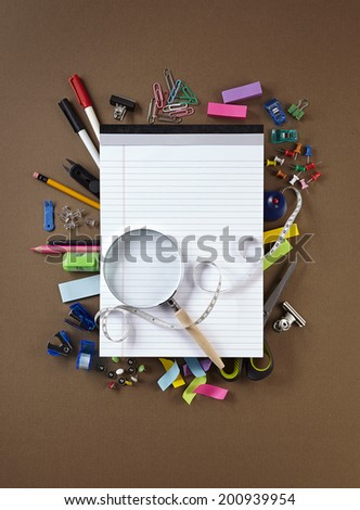 Photo of office and student gear over brown background - Back to school concept - stock photo