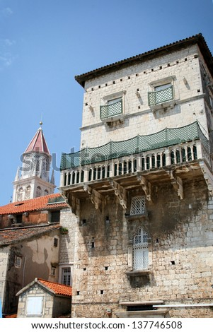 Photo of old stone house and church tower in town Trogir in Dalmatia - stock photo