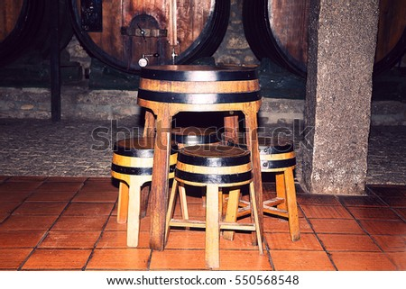 photo of Old wooden barrels used as tables and chairs