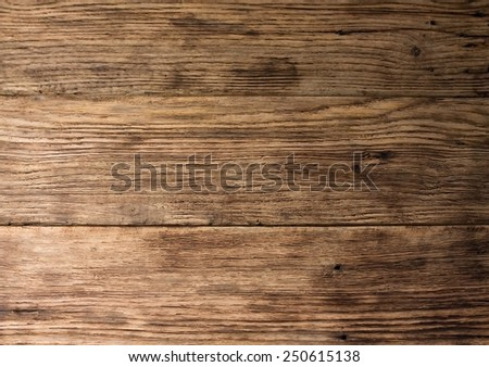 Photo of old worn wooden board with interesting texture of wood material - stock photo