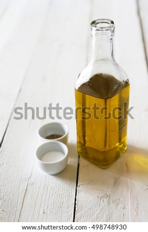 Photo of olive oil bottle, salt and pepper