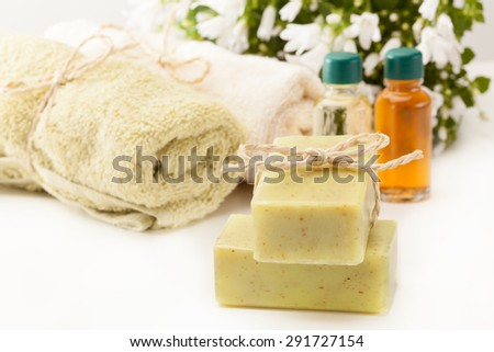 Photo of olive soap and essential oil  - stock photo