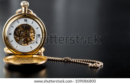 Photo of opened old vintage pocket clock against the black background - stock photo