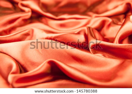 photo of orange silk background - stock photo