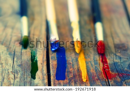 Photo of paint brushes and color stripes - stock photo