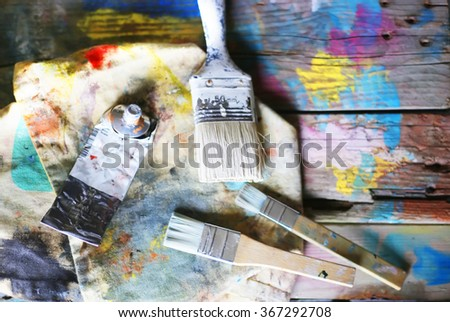 Photo of paint brushes and tubes - stock photo