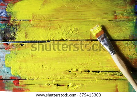 Photo of paint brushes on wooden background