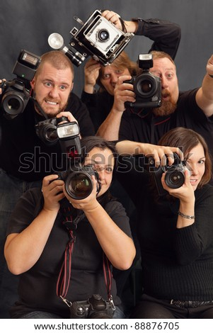 Photo of paparazzi fighting for space to take photos. Focus on the female in front. - stock photo