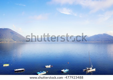 photo of picturesque lake and boats