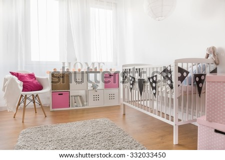 Photo of pink and white baby girl room - stock photo