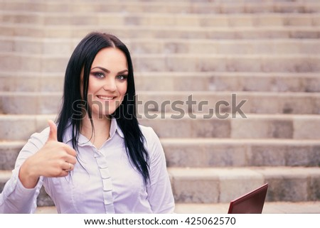 photo of portrait of a happy beautiful young successful woman - stock photo