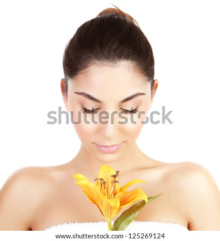 Photo of pretty woman enjoying dayspa, closeup portrait of attractive female with closed eyes holding yellow lily flower isolated on white background, luxury spa salon, beauty treatment concept - stock photo