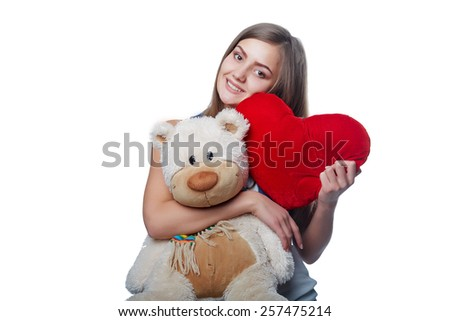 Photo of pretty woman hug cute soft toy, closeup portrait of pretty brunette female with teddy bear and red handmade heart isolated on white background, Valentine day, love and happiness concept - stock photo