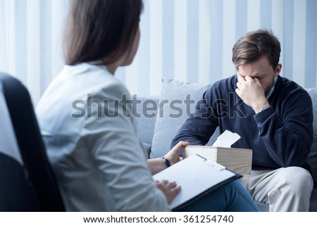 Photo of professional female counselor helping depressed man