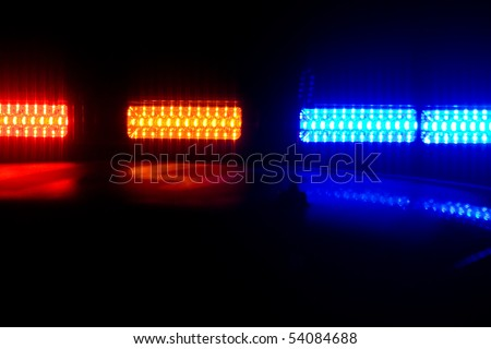 Photo of red and blue LED police roof lights on a police cruiser