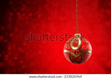 photo of red background and one red retro xmas ball  - stock photo