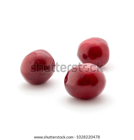 Photo of red beautiful cherries isolated on white background