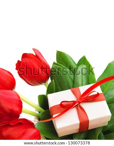 Photo of red tulips flowers and small white gift box on fresh green leaves, romantic still life for happy mothers day isolated on white background, festive present, birthday holiday, cute surprise - stock photo