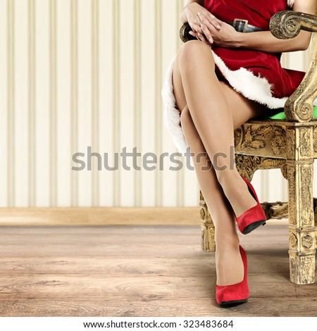 photo of retro chair and woman with long legs and red heels and red dress