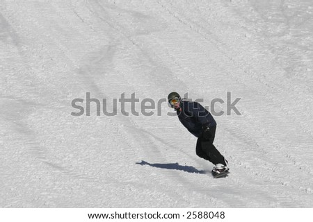 Photo of riding snowboarder on 200mm zoom