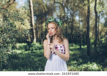 Photo of romantic woman in fairy forest.  - stock photo