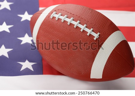 Photo Of Rugby Ball On An American Flag - stock photo