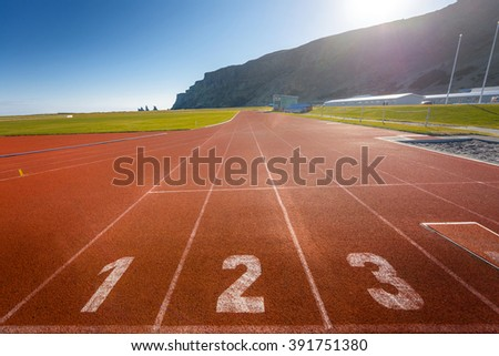 Photo of running track outdoors with beautiful nature  - stock photo