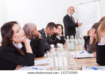 Photo Of Sad Business Team Attending The Seminar - stock photo