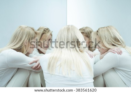 Photo of sad woman with anxiety disorder - stock photo