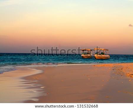 Photo of Sailboat along Maldive coastline in dusk - stock photo
