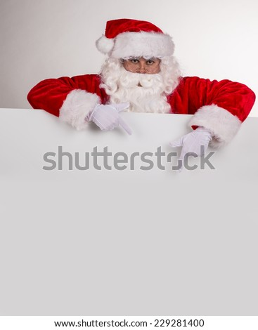 Photo of Santa Claus with eyeglasses.