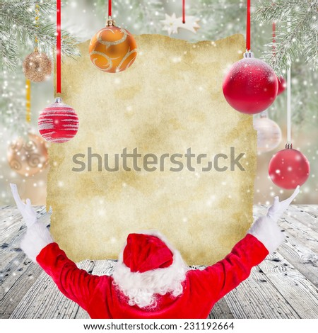 Photo of Santa Claus with old big paper. - stock photo