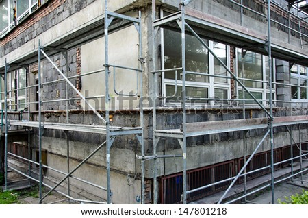 Photo of scaffolding set during building renovation - stock photo