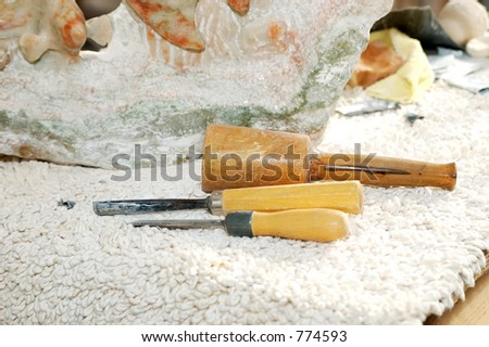 Photo of Sculpture Tools and Pieces of Marble - stock photo