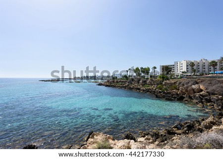Photo of sea in protaras, cyprus island with rocks and hotels.