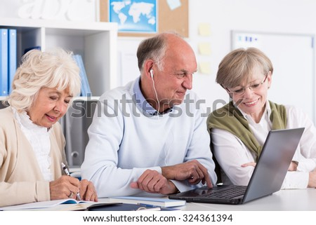 Photo of senior students using computer as a learning tool - stock photo