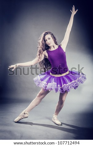 Photo of sexy brunette ballerina in retro style
