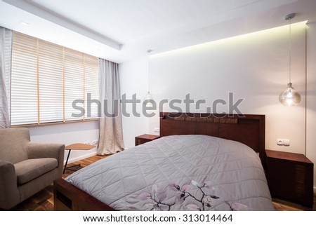 Photo of simple design light bedroom with double bed - stock photo
