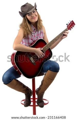 Photo of sitting cowgirl with the guitar on white background - stock photo