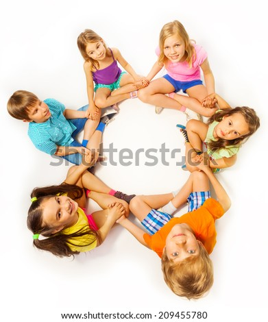 Photo of six kids in a lotus pose - stock photo