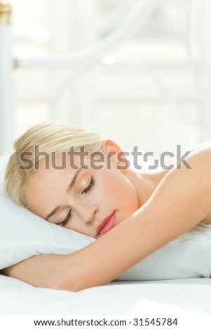 Photo of sleeping young woman at home