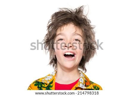 Photo of sleepy young boy looking at camera with open mouth,yawning. Isolated on white background - stock photo