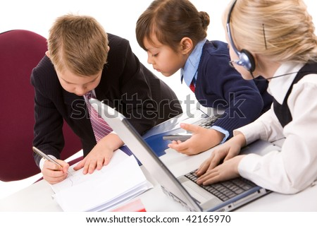 Photo of smart girl looking at serious boss writing on paper in working environment