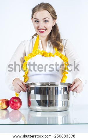 Photo of smiling homemaker with pan on white background