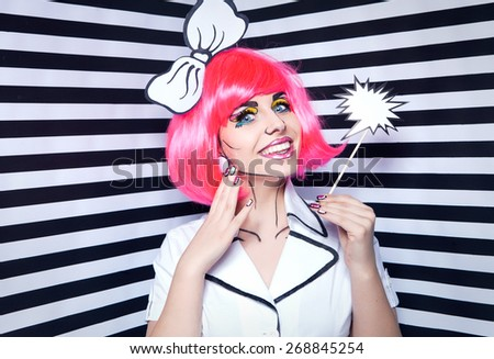 Photo of smiling young woman with talk bubble and professional comic pop art make up and accessories - stock photo